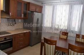 Кухня и трапезария в едно помещение.Цялостно обзавеждане на жилището с мебели от масив.