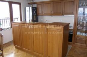Кухнята ,ТВ Шкафа и трапезарната витрина са събрани в една композиция