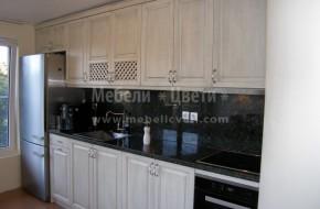 В кухнята- хладилника,миялната ,фурната и котлоните са на MIELE