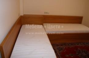 Детска стая от масивна череша по поръчка с ъглови легла с ракла и гардероб.