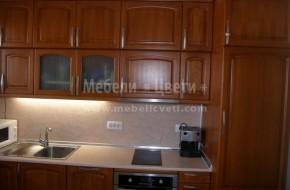 Масивна букова кухня шкафове на две нива по поръчка с гръб и плот от гетинакс и вградени електрически уреди.Цена за нестандартни шкафове на два реда 3980 лева.
