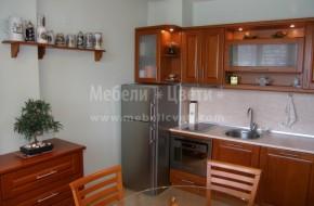 Цялостно обзавеждане на кухненски бокс с мебели от масивен бук.Цена на кухненските шкафове-3300лв.Нестандартна вградена фурна на Ariston с височина 450мм.